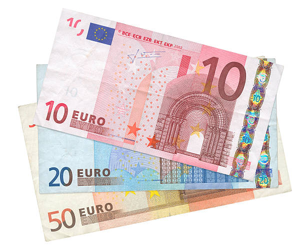 three Euro banknotes close-up of three Euro banknotes isolated on white background, see also: european currency stock pictures, royalty-free photos & images