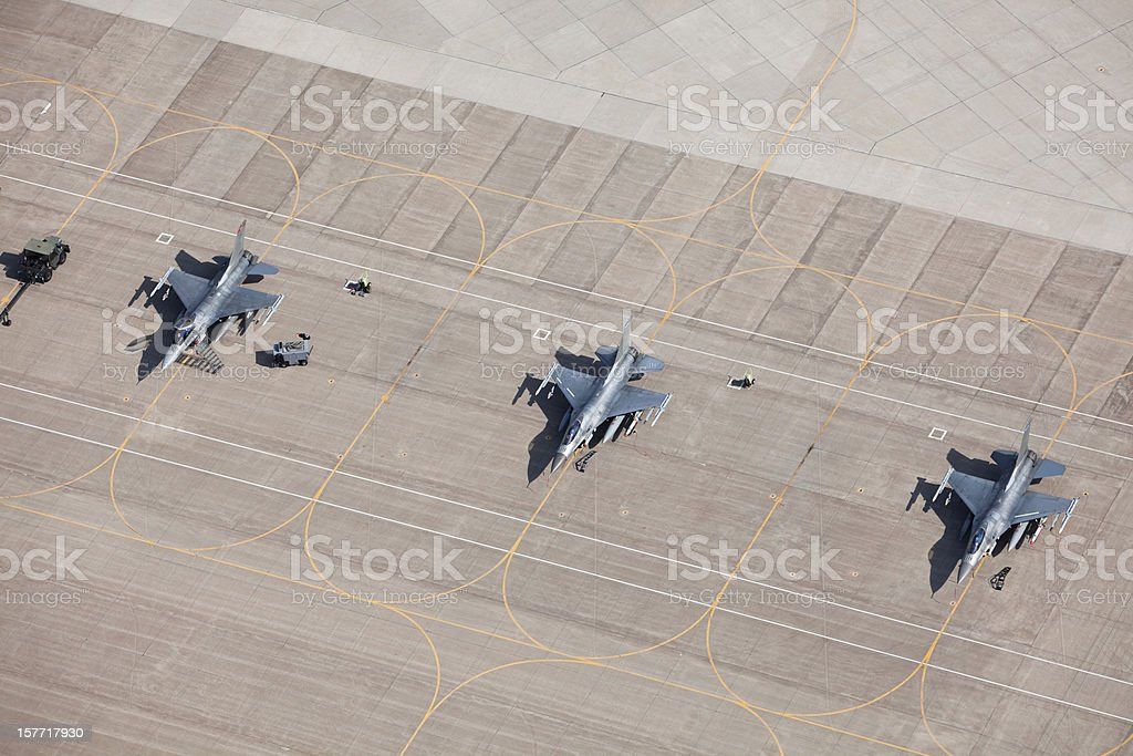 Three F-16 Fighter Jets on Tarmac Ready for Flight stock photo