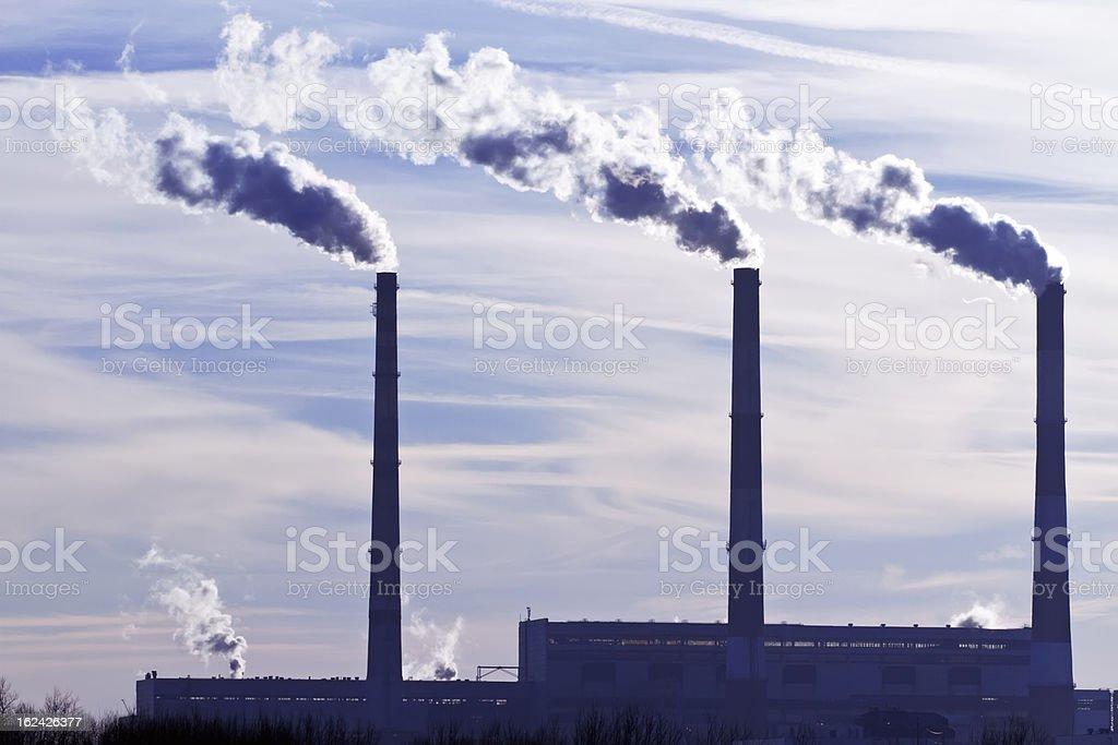 Three factory pipes royalty-free stock photo
