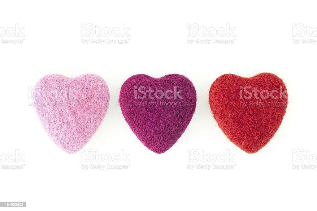 Three felt hearts in a row stock photo