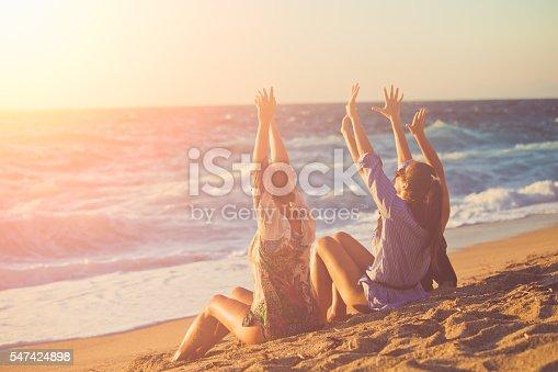 Three female friends having fun at the beach