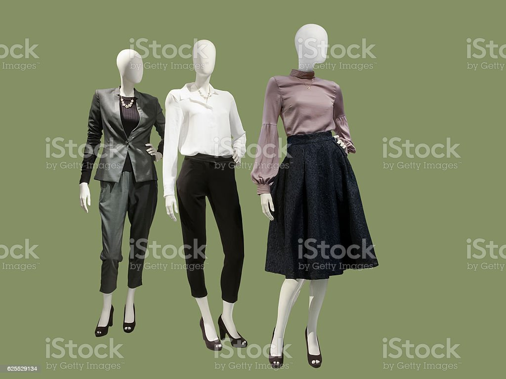 Three female mannequins dressed with fashionable clothes. stock photo