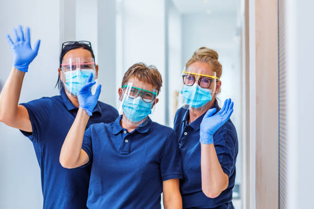 Three female medical assistants in a surgery stock photo