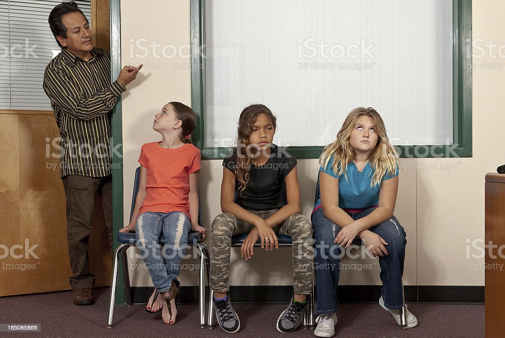 Three female students waiting for the principal stock photo