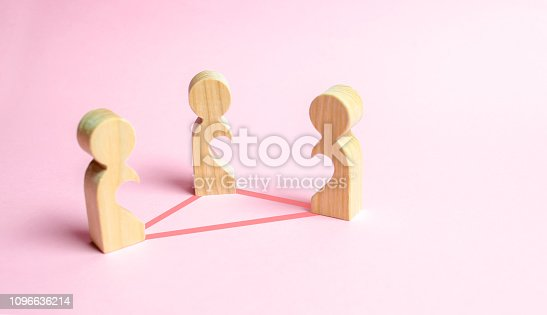 istock Three figures of people with voids inside the body in the form of halves of the heart are connected by lines. Love triangle concept. Unrecognized love, love relationships, confrontation of lovers. 1096636214