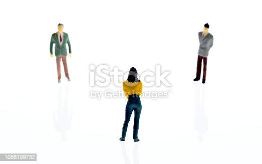 Three figurines standing on white background.