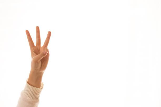 três dedos contagem de sinal, a imagem de uma children'sfinger apontando - três objetos - fotografias e filmes do acervo