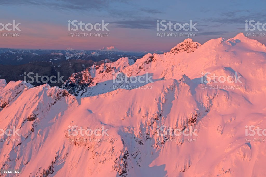 Three Fingers Mountain Red Lighting Aerial Photo North Cascades Mountains Winter View stock photo