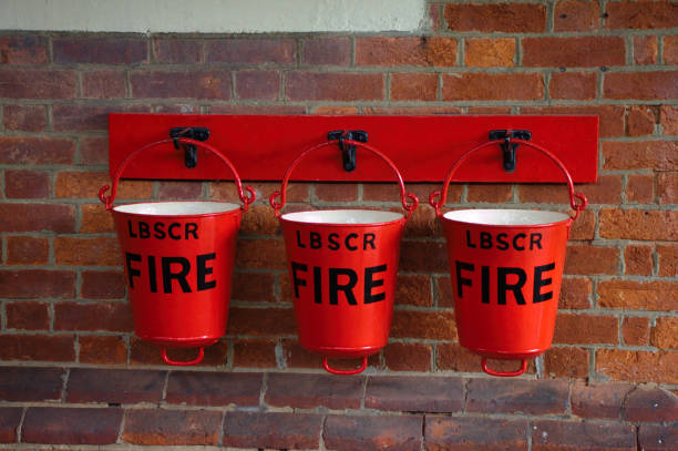Three fire buckets in a row stock photo