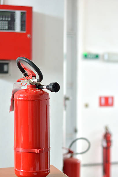 Three Fire Extinguishers and Fire Alarm Box – Foto