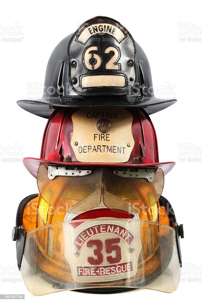 Three firefighter's helmets stock photo