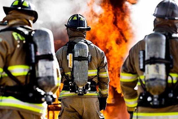 Three Firefighters stock photo