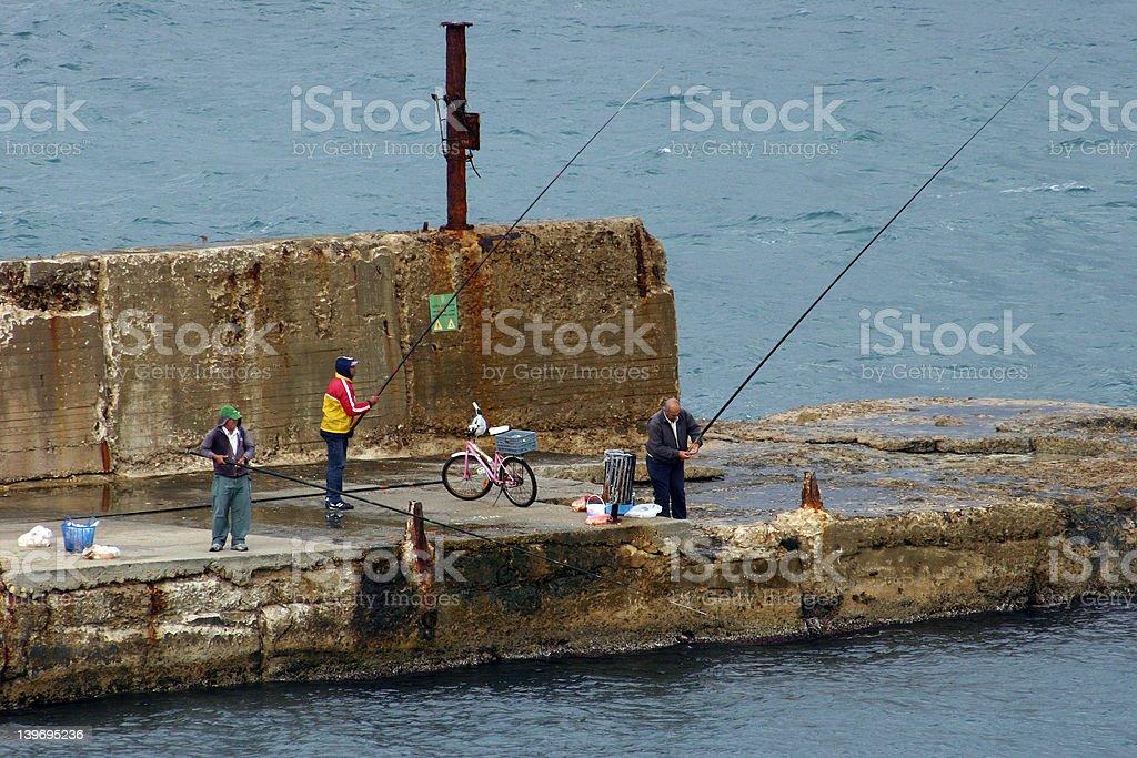 three fisherman royalty-free stock photo