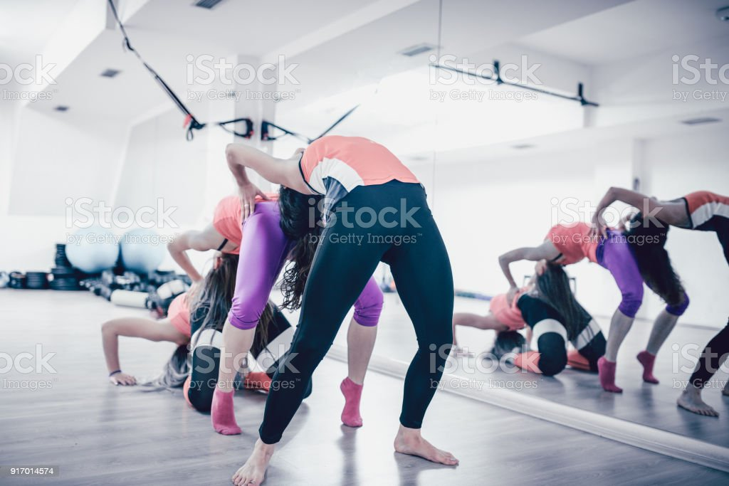 Three Fitness Girls Bending Over One Another Royalty Free Stock Photo
