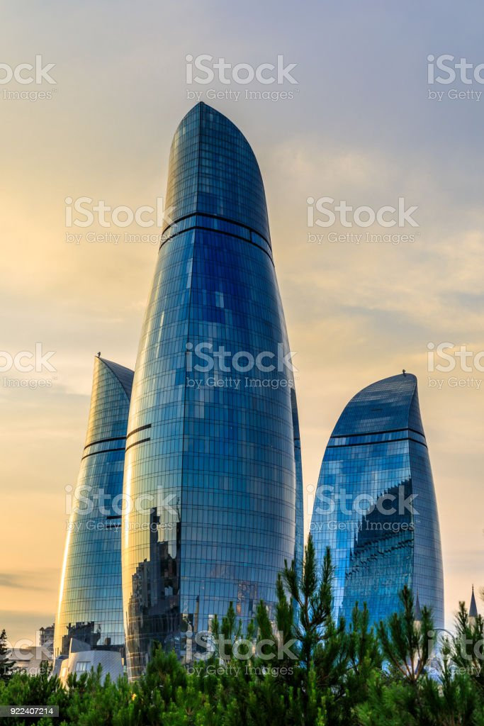 Three flame towers skyscrapers on the sunset in the city center, Baku, Azerbaijan stock photo