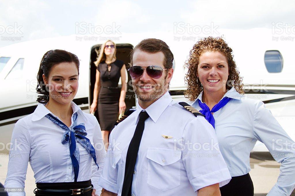 Three flight crew stock photo