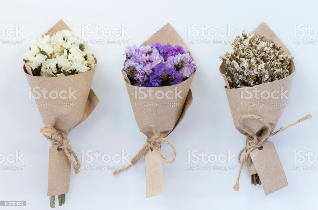 Cтоковое фото Three flower bouquet on white background.