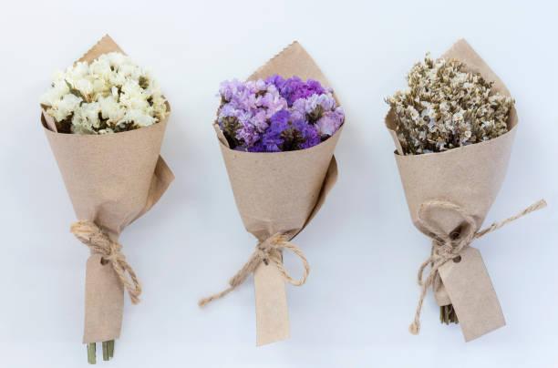Three flower bouquet on white background. stock photo