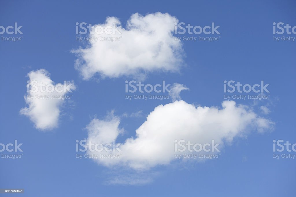 three fluffy white clouds royalty-free stock photo