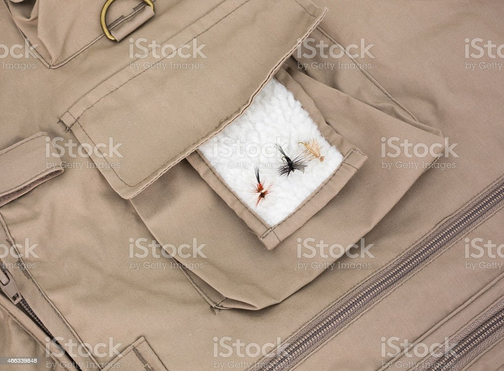 Three fly fishing flies on fleece patch with vest stock photo