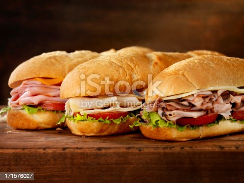 Three 12 inch  Submarine Sandwiches- Turkey, Ham and Cheese, Roast Beef and Swiss with Lettuce and Tomato on Crusty Buns - Photographed on Hasselblad H3D2-39mb Camera