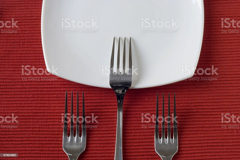 three forks and porcelain plate royalty-free stock photo