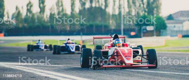 Three Formula Race Cars On The Race Track Stock Photo - Download Image Now