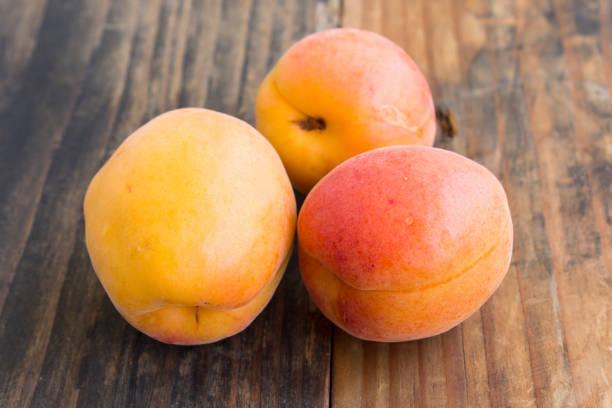 Three Fresh Apricots stock photo