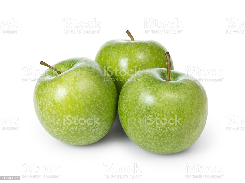 three fresh green granny smith apples stock photo