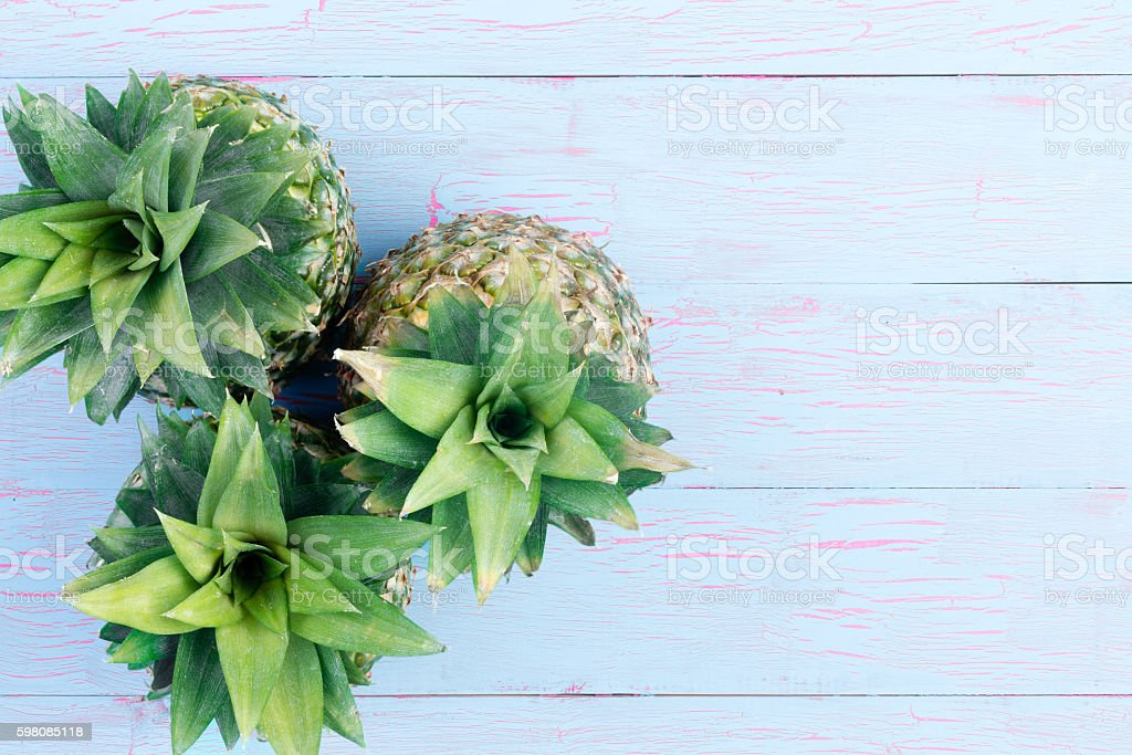 Three fresh pineapples viewed from the top stock photo
