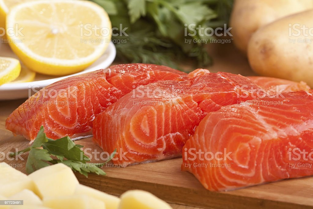 three fresh raw salmon pieces royalty-free stock photo