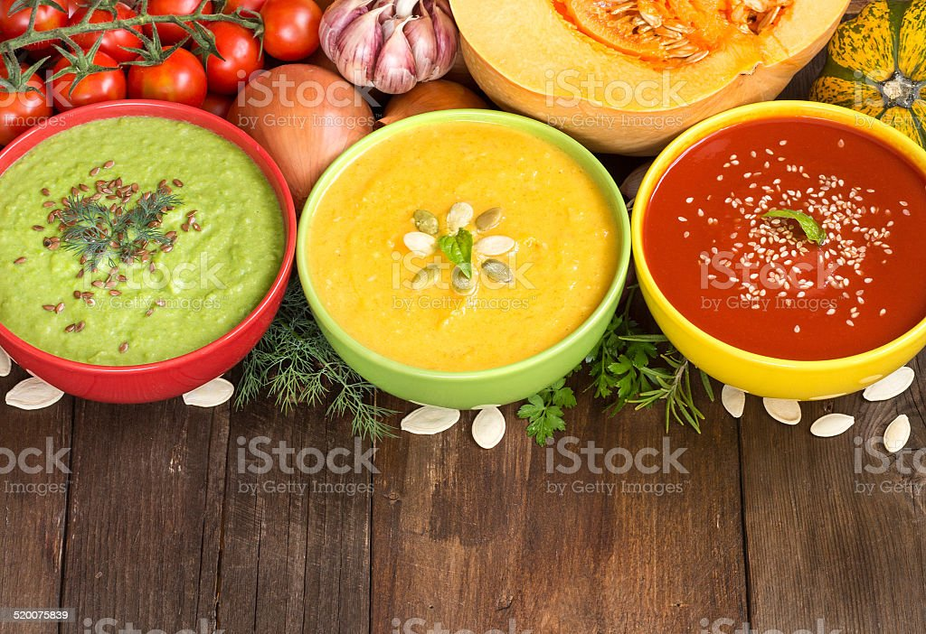 Three fresh soups and vegetables stock photo