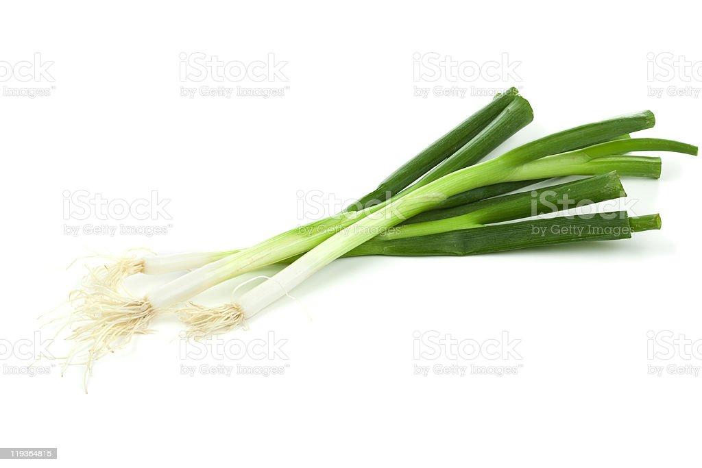Three fresh spring onions on a white background stock photo