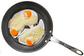 Three Fresh Sunny Side Up Eggs Fried With Edam Cheese Slices In Large Frying Pan Isolated On White Background