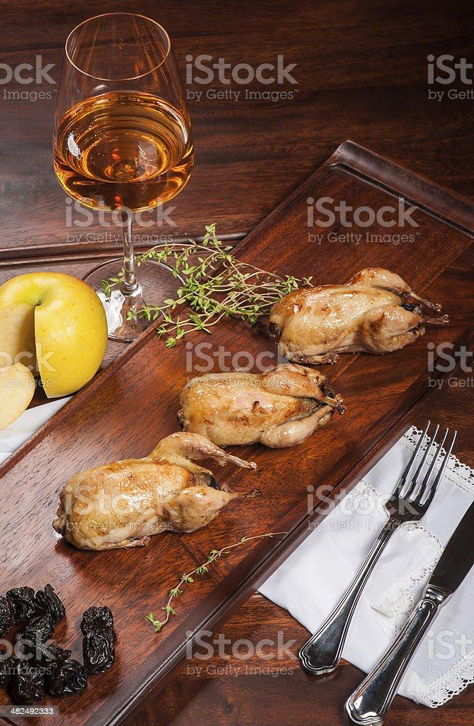 Three fried quails stock photo