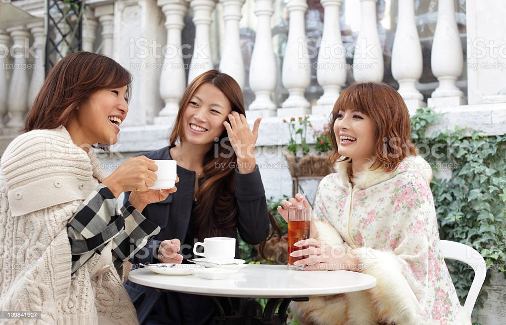Three Friends are in a Cafe royalty-free stock photo