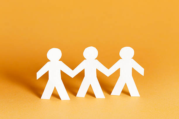 Three friends as paper cutouts stock photo