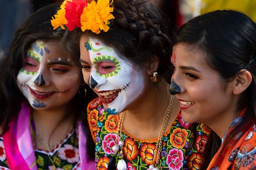 Three Friends at the Día de los Muertos Festival in Oaxaca