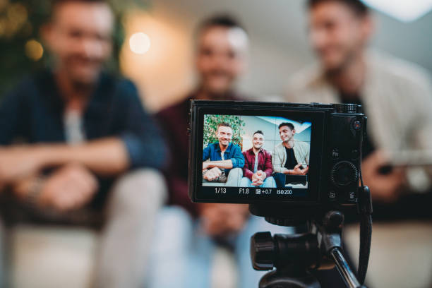 Three friends doing a vlog video together stock photo