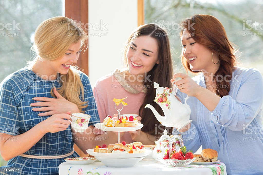 Three Friends Having Afternoon Tea stock photo