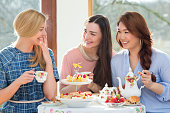 Three female friends having afternoon tea.