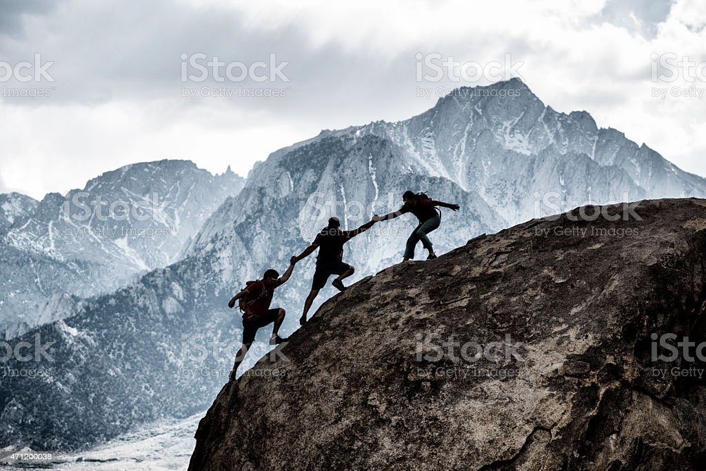three friends helping stock photo