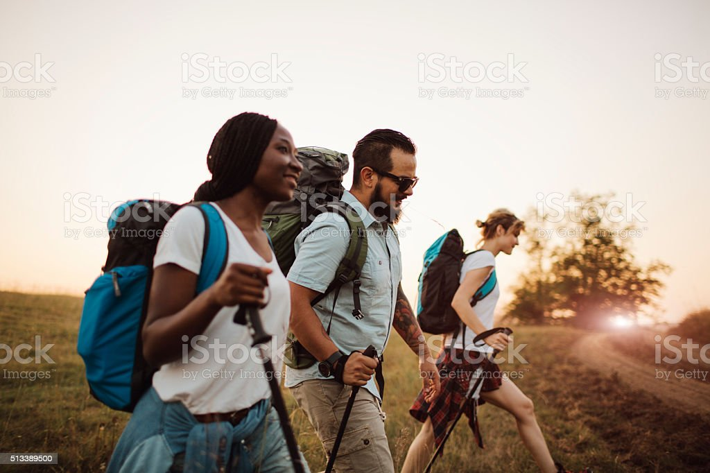 Three Friends Hiking Together. stock photo