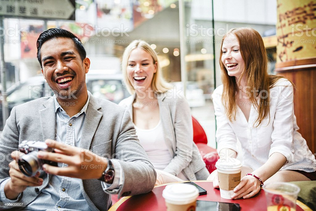 Three friends in Hong Kong cafe royalty-free stock photo