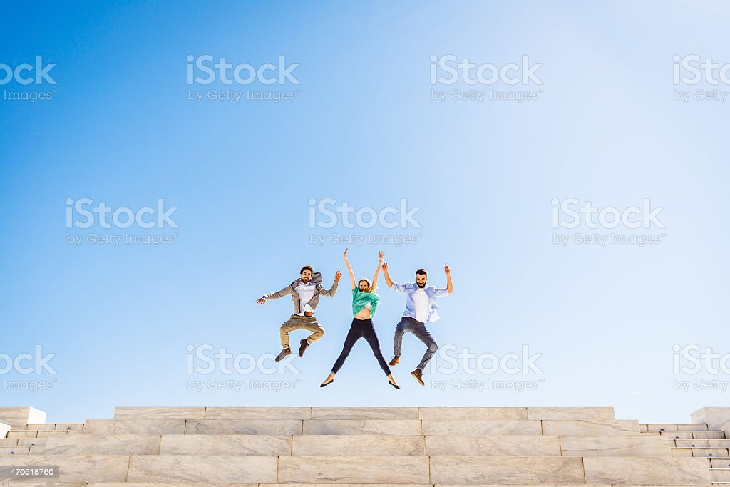 Trois amis, sauter - Photo