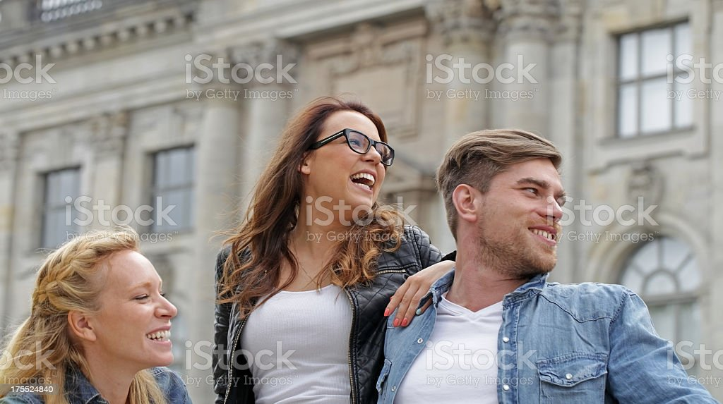 three friends laughing out loud stock photo