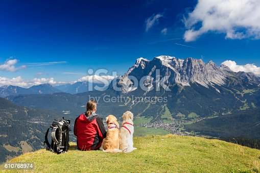 istock Three friends, man with  his dogs are looking to Zugspitze 610768974