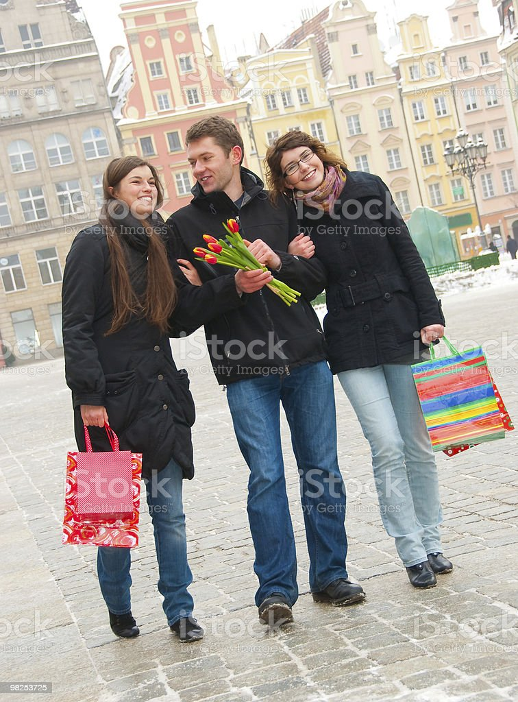 Three friends on a street royalty-free stock photo