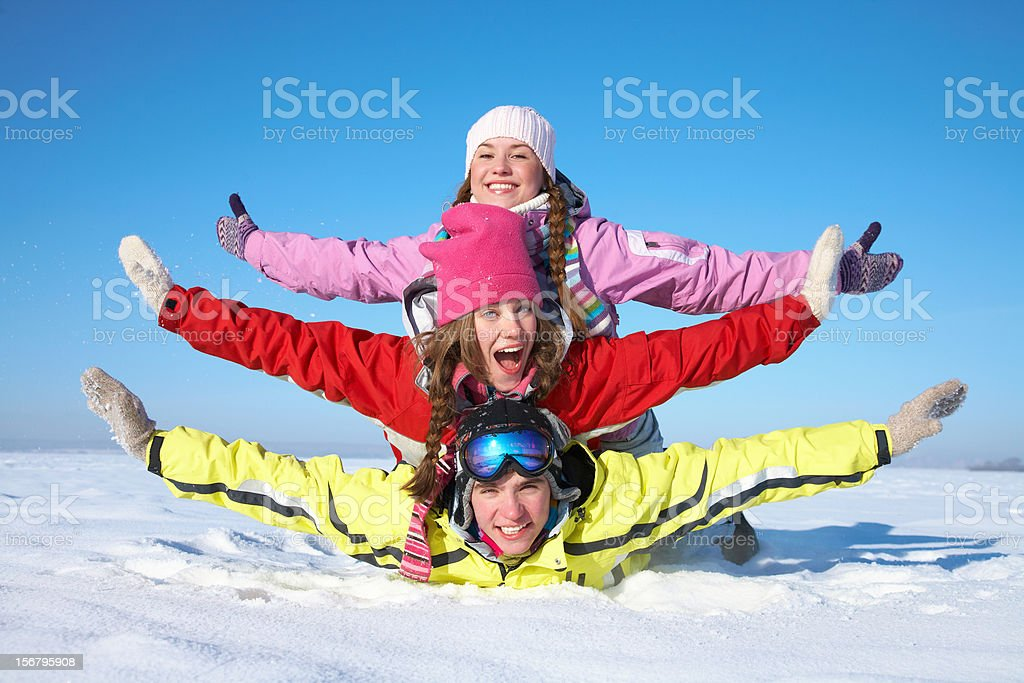 Three friends on top of each other on the snow royalty-free stock photo