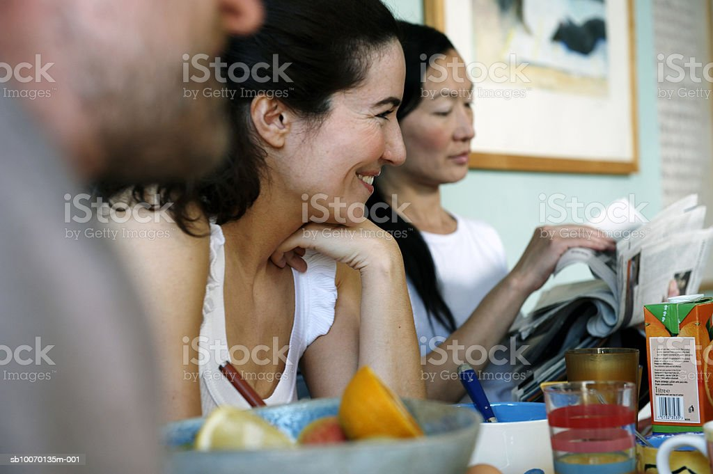 Three friends sitting at table 免版稅 stock photo